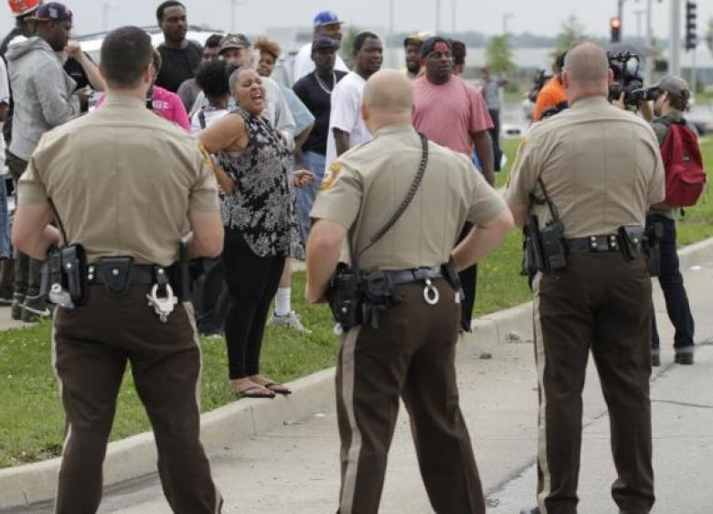 After Two DOJ Warnings, Ferguson Police Still Refuse To Wear Name Tags
