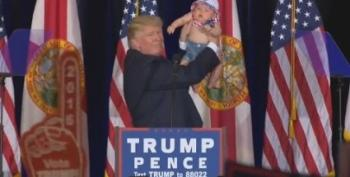 Donald Trump Dangerously Takes Baby On Stage At Tampa Rally