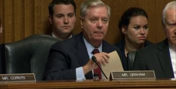 Lindsey Graham Grills Trump's New FBI Nominee On Don Jr