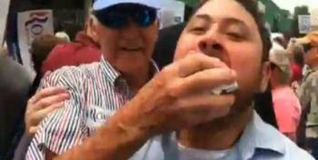 Romney Supporter Silences Protester By Shoving Handkerchief In His Mouth