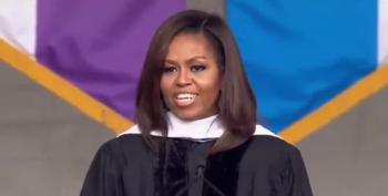 Michelle Obama: 'In America We Don't Build Walls To Keep People Out'