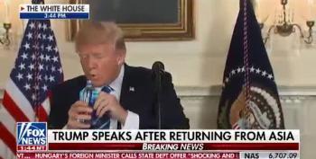 Trump Battles With Water Bottle During Presser