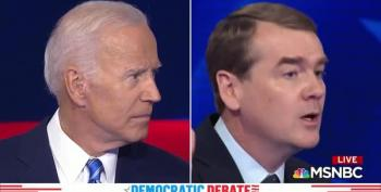 Michael Bennet Says 'Here, You Forgot This,' And Hands Joe Biden His Baggage