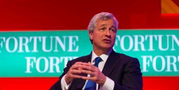 Dimon Wins Big Pay Hike Despite JPMorgan's Jumbo Fines