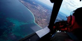 Wild Weather Suspends Search For Crashed Malaysia Jet