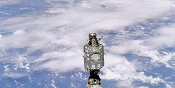 US Astronauts Step Out On Spacewalk For Repairs