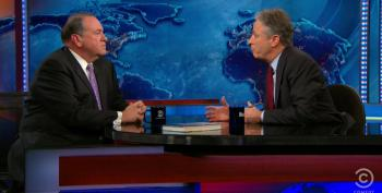 Jon Stewart Calls Out Mike Huckabee For Palling Around With Ted Nugent