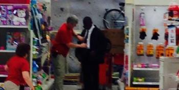 Target Worker Stops To Teach A Young Man How To Tie A Tie For Job Interview
