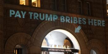 Artist Beams 'Pay Trump Bribes Here' Onto Trump Hotel DC