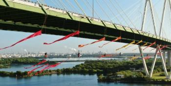 Also In Houston, Greenpeace Shuts Down Bridge Over Fossil Fuel