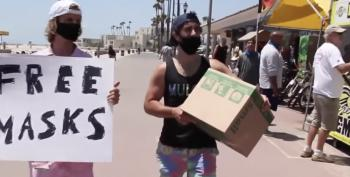 Two Guys Try To Hand Out Free Masks At Huntington Beach. It Does Not Go Well