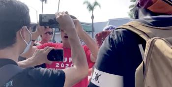 WATCH: Mask-free Trump Cultists Cough On Biden Supporters On Purpose