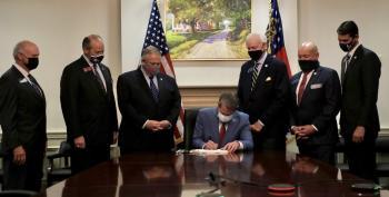 Georgia Gov. Signed Voter Suppression Law Under Portrait Of Plantation