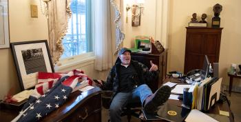 Capitol Rioter Hawking Autographed Pics Of Himself In Nancy Pelosi's Office