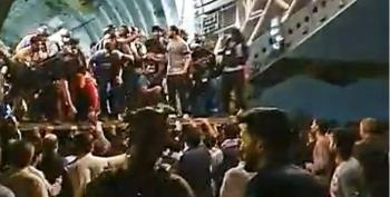 WATCH: Chaos At Kabul Airport As Hundreds Huddle Together To Board C-17