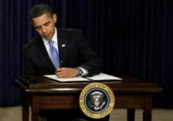obama-signing-alone.preview-300x210.jpg