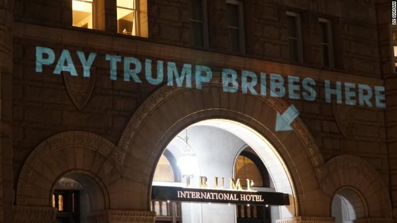 Artist Beams 'Pay Trump Bribes Here' Onto Trump Hotel DC ...