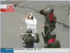 burma-soldiers-beating-protestors.jpg