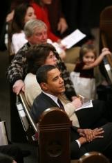Obama sits in a church pew