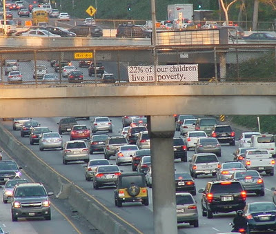 children in poverty sign freeway.jpg